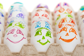 Funny eggs with painted eyes and mouth