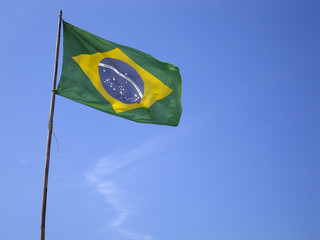 Foto op Canvas Brazilië Brazilian flag on blue sky