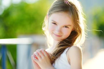 Adorable little girl on sunny summer day