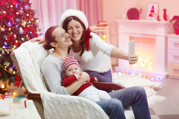 Christmas concept: happy family take selfie in decorated room