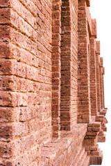 Large brick wall beside the door.
