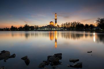 Perfect reflection of a floating mosque Masjid Tengku Tengah Zaharah in Kuala Ibai, Terengganu, Malaysia during sunset