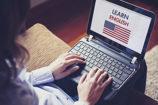 Woman learning english at home with a computer laptop.