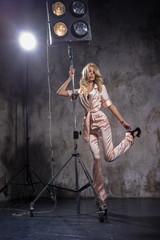 Beautiful blonde in a pink pajamas