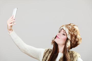 Woman taking selfie photo
