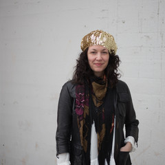 Portrait of stylish woman with gold beret
