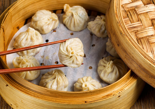 Freshly steamed Chinese dumplings out of bamboo steamer