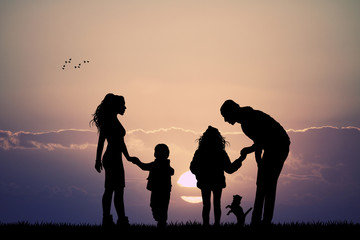 happy family with dog at sunset