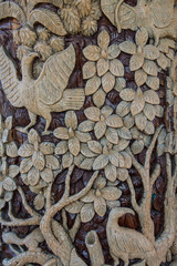 Carved wooden latticework  pattern of tree with bird