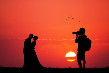 photographer wedding service at sunset