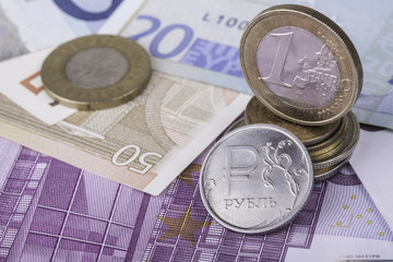 coin one ruble and the European currency: banknotes, euro coins