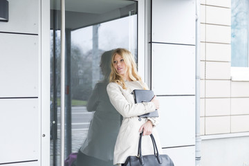 Young woman waiting for a business to open