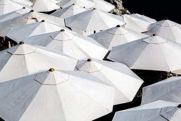 Many sun umbrellas seen from above, Croatia summertime.