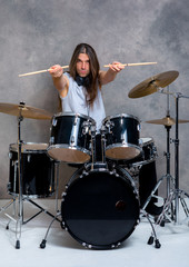 musician with his black drum set