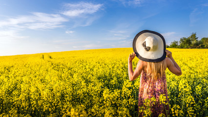 Woman on a field of rapeseed