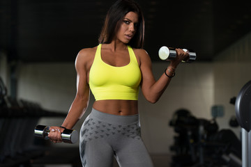 Mexican Woman Doing Heavy Weight Exercise For Biceps