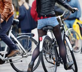 Fototapete - Bikes in the evening, in traffic