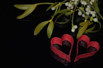 Red hearts and mistletoe