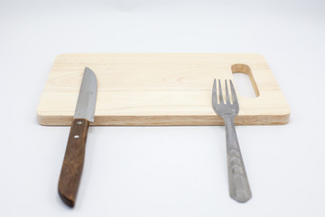 Wooden cutting board and knife