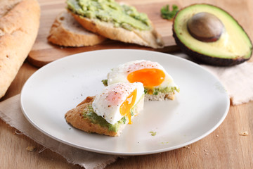 poached eggs with avocado salad .