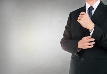 Businessman button up in suit on concrete background texture.