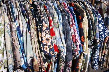 row of Hawaiian shirts on rack