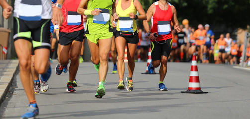 male and female during the run of the marathon race