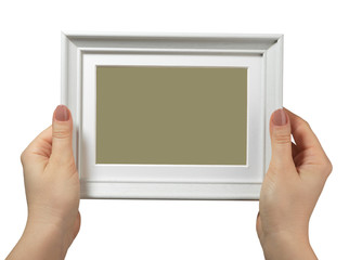 female hand holding a wooden frame isolated on white background.
