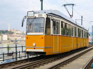 Historic yellow tram on the street, Budapest, Hungary