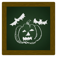 Simple doodle of a pumpkin and bats