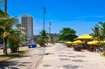 Wall Mural - Barra da Tijuca beach with mosaic of sidewalk  in Rio de Janeiro. Brazil