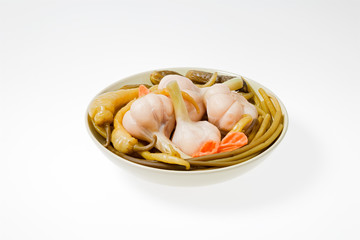 The pickled vegetables on the plate. Shot on a light background.
