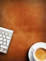 Coffee mug on the table with a keyboard