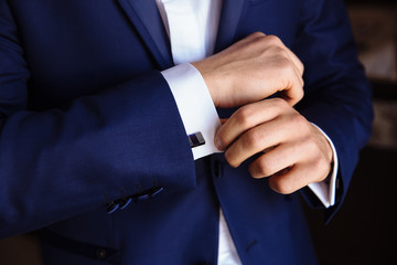 Man hands with cufflinks. Elegant gentleman clother