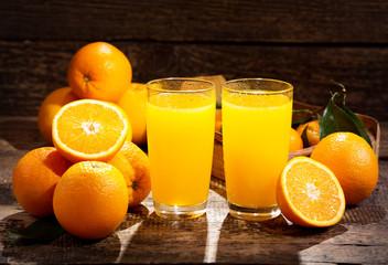 glasses of orange juice with fresh fruits