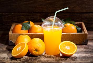 glass of orange juice with fresh fruits