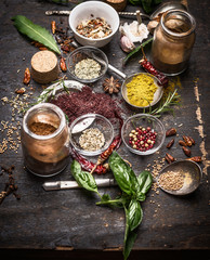 Herbs and spices selection on dark rustic  grunge background