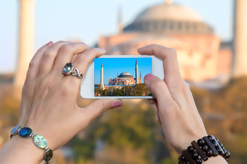 Woman taking Photo with camera phone in Istanbul city