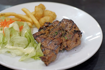 grilled pork steak with french fries