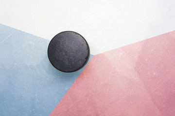 old hockey puck is on the ice with czech republic flag