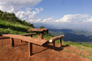 Table and chairs with grass, mountain and cloudy sky view of Chi