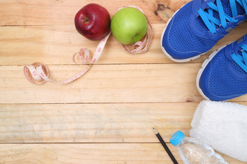 Wall Mural - Sport shoes and water with set for sports activities on tiled floor.sports, fitness, concept of weight loss