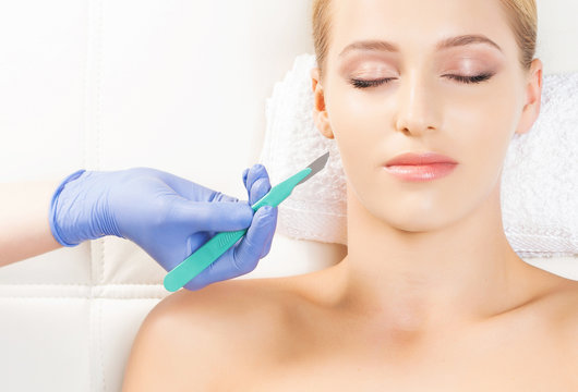 Beautiful woman getting face lifting operation. Aging and plastic surgery concept.