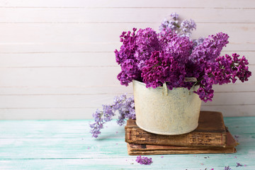 Background  with fresh lilac flowers in bowl
