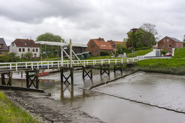 Street view od a town Toenning on the Eider river near its mouth at the North Sea in the district of Nordfriesland in the German state of Schleswig-Holstein.