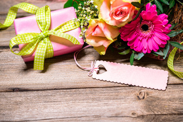 Background with bouquet of flowers and gift box