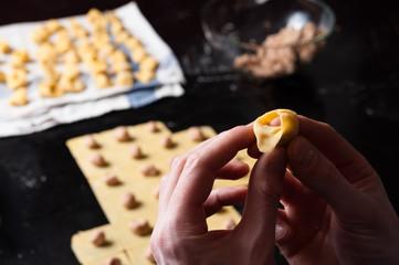 Hand making tortellini