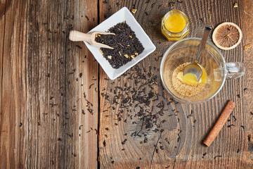 Brown sugar and honey in a tea glass and cinnamon and orange sli