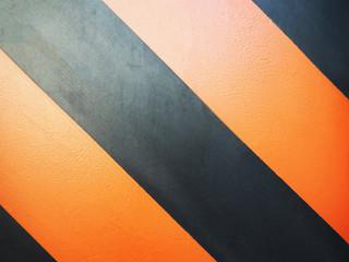 Orange and black color striped background