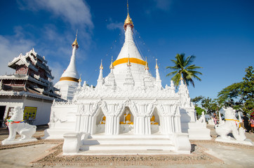 the white pagoda in a twilight at phar that doi kong moo temple,